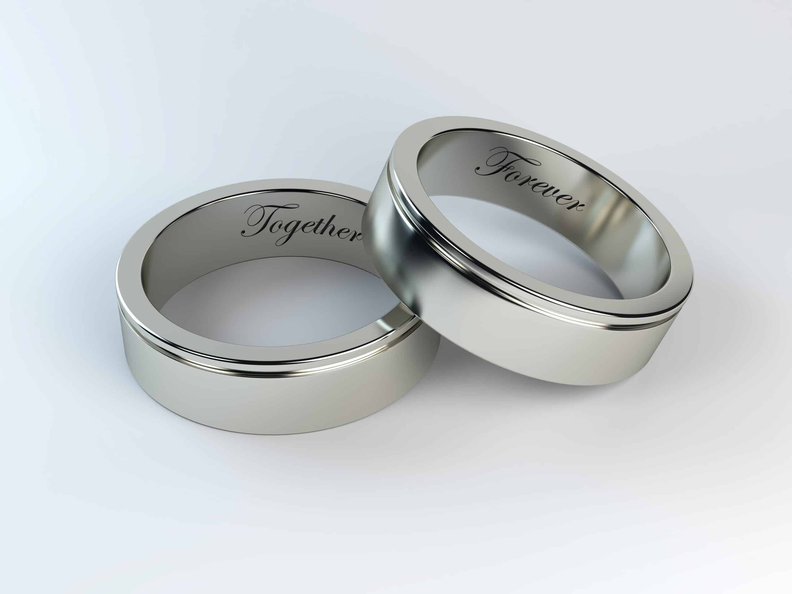 two silver rings inscribed together and forever