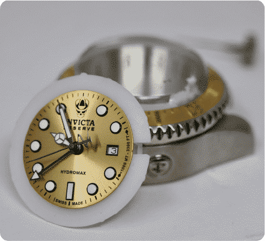 gold invicta watch face leaning on watch